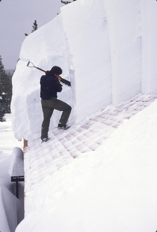 Winterkeepers Must Remove Snow All Winter To Keep Roofs From Caving In.  Jeff Henry,